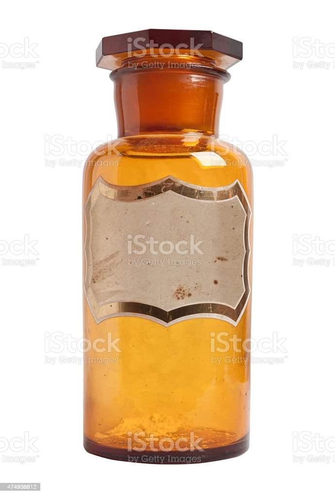 Old fashioned drug bottle with label, isolated. stock photo