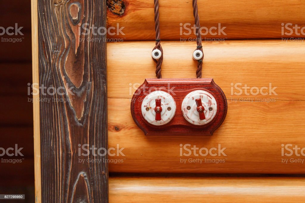 Old fashioned electricity switchs, electric wire on a wooden wall. stock photo