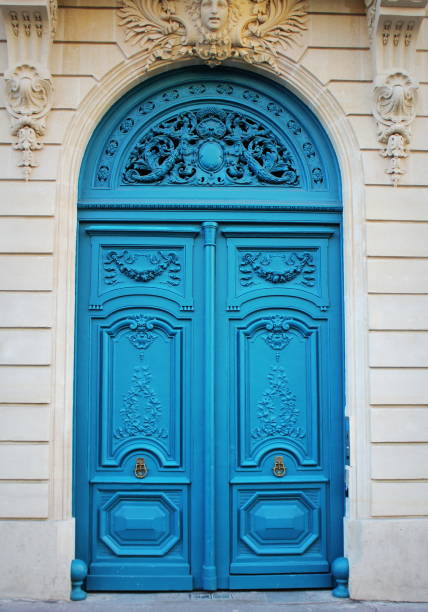 Old fashioned front door entrance, white facade and blue door, Paris, France stock photo
