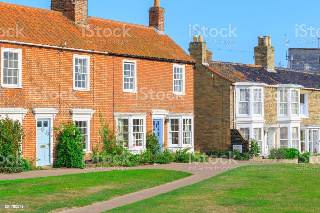 Old fashioned holiday brick cottages in Southwold, Suffolk, UK stock photo