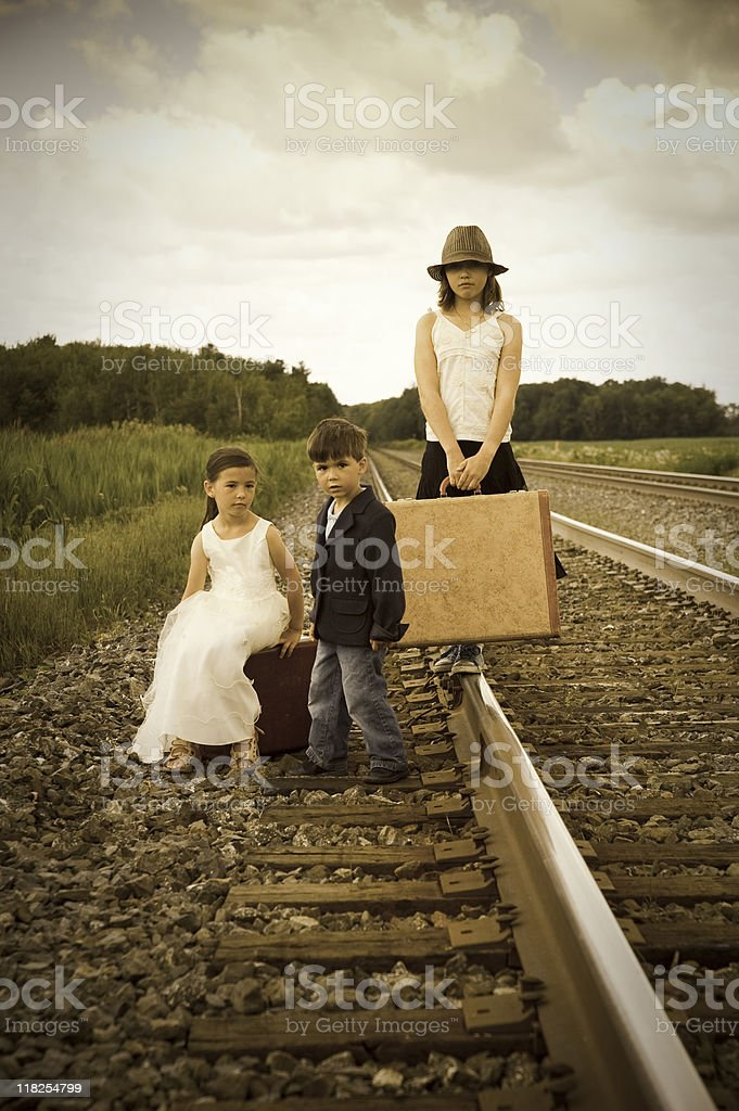Old fashioned kids on a railroad royalty-free stock photo