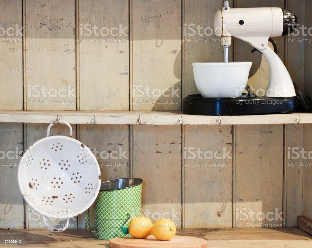 Old Fashioned Kitchen Equipment on Antique Hutch