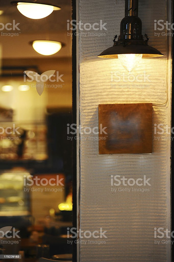 Old fashioned lamp on wall royalty-free stock photo