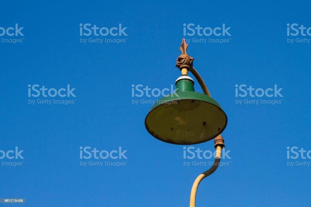 Old fashioned lamp post against a clear blue sky stock photo
