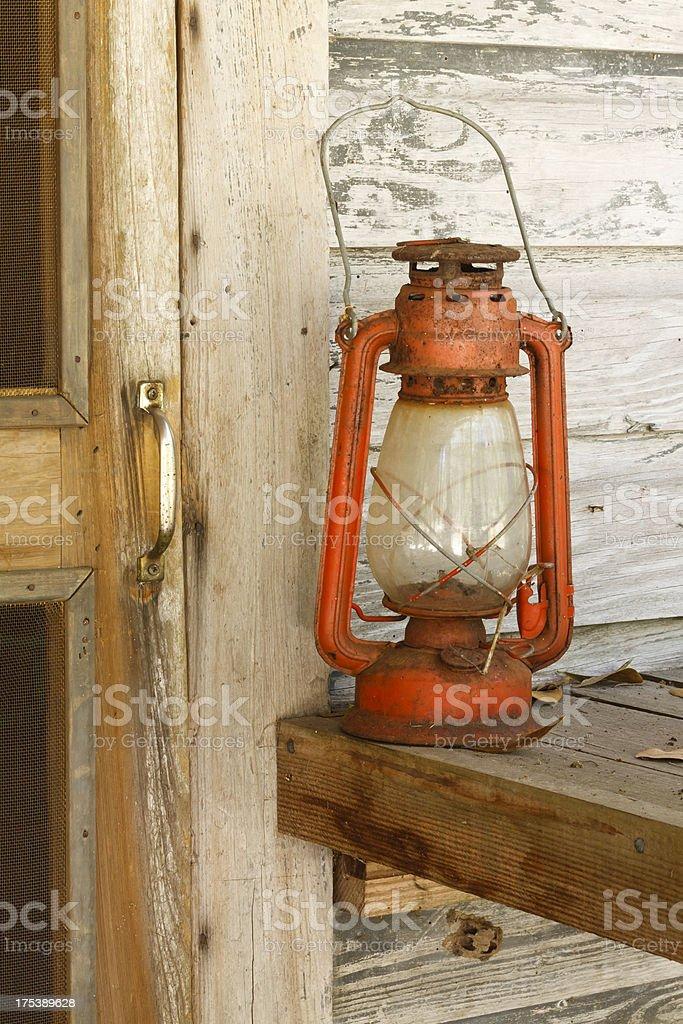 Old Fashioned Lantern On Rural Farmhouse Porch stock photo