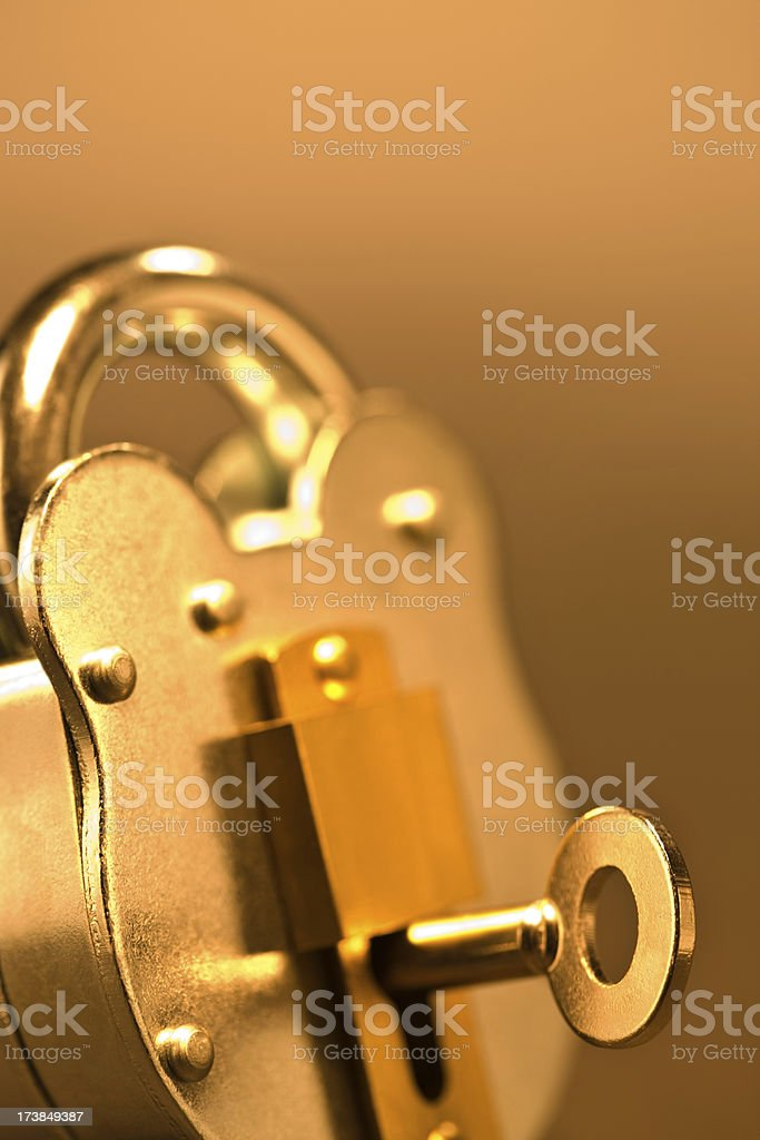 Old fashioned lock with a key plugged in royalty-free stock photo