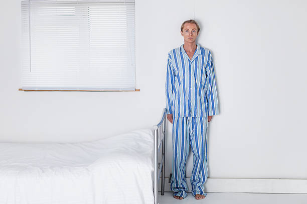 Old Fashioned Man In His Stark Bedroom stock photo