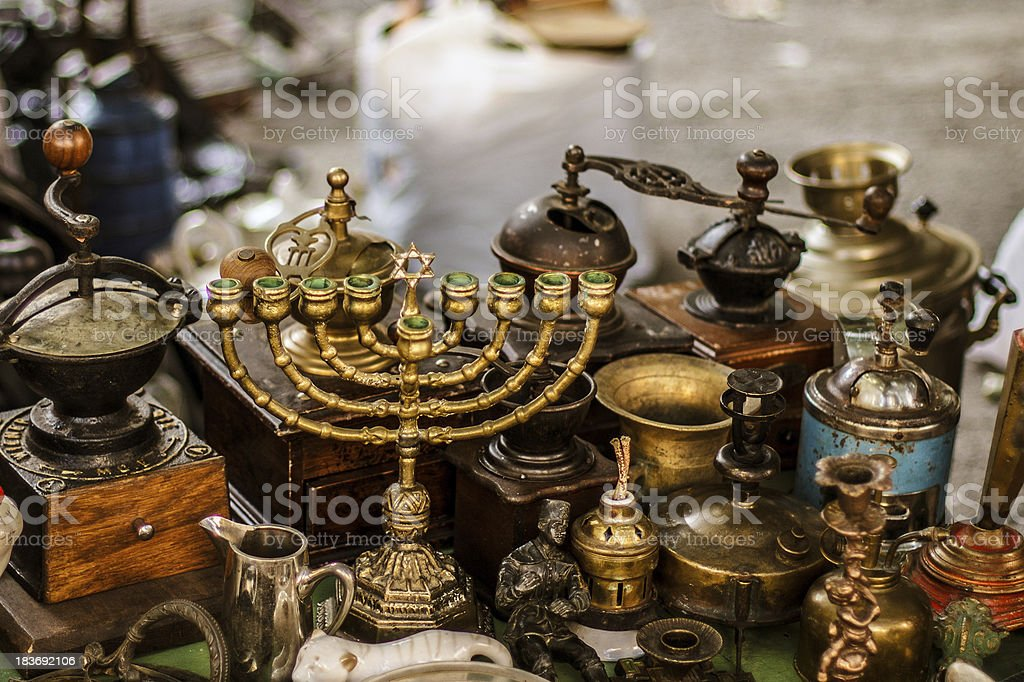 Old fashioned menorah and other antique decorative items on the stock photo