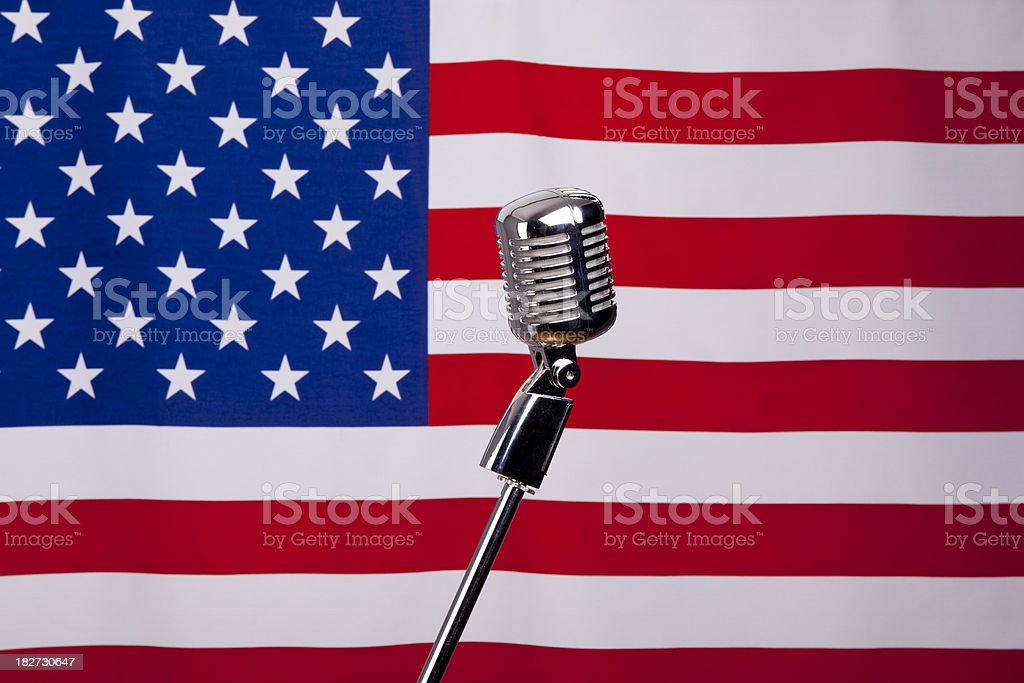 Old fashioned microphone on american flag royalty-free stock photo