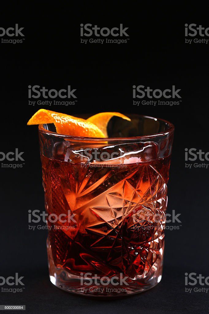 Old fashioned Negroni cocktail on the black background stock photo