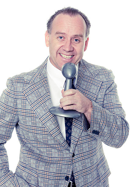 Old Fashioned News Anchorman A retro-processed news anchorman against a white background. radio dj stock pictures, royalty-free photos & images