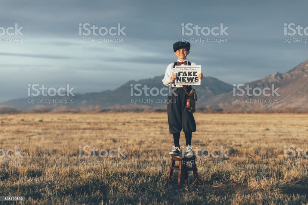 Old Fashioned News Boy Holding Fake Newspaper stock photo