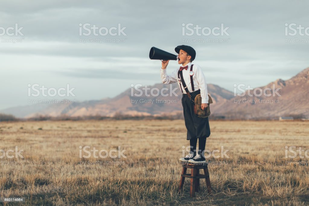 Old Fashioned News Boy Yelling Through Megaphone