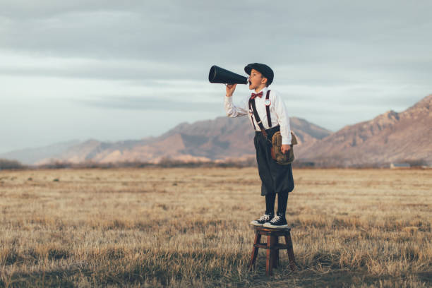 Old Fashioned News Boy Yelling Through Megaphone stock photo