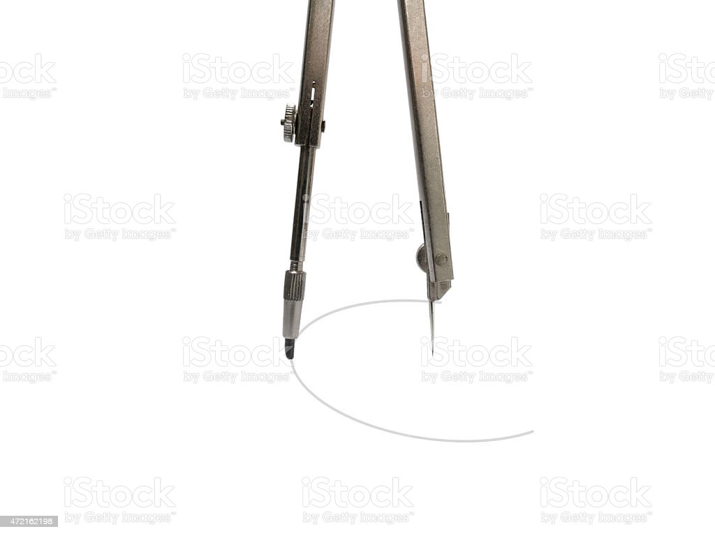 Old fashioned pair of compasses drawing a circle stock photo
