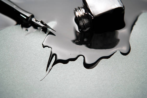 old fashioned pen with spilled black ink - ink well stock photos and pictures