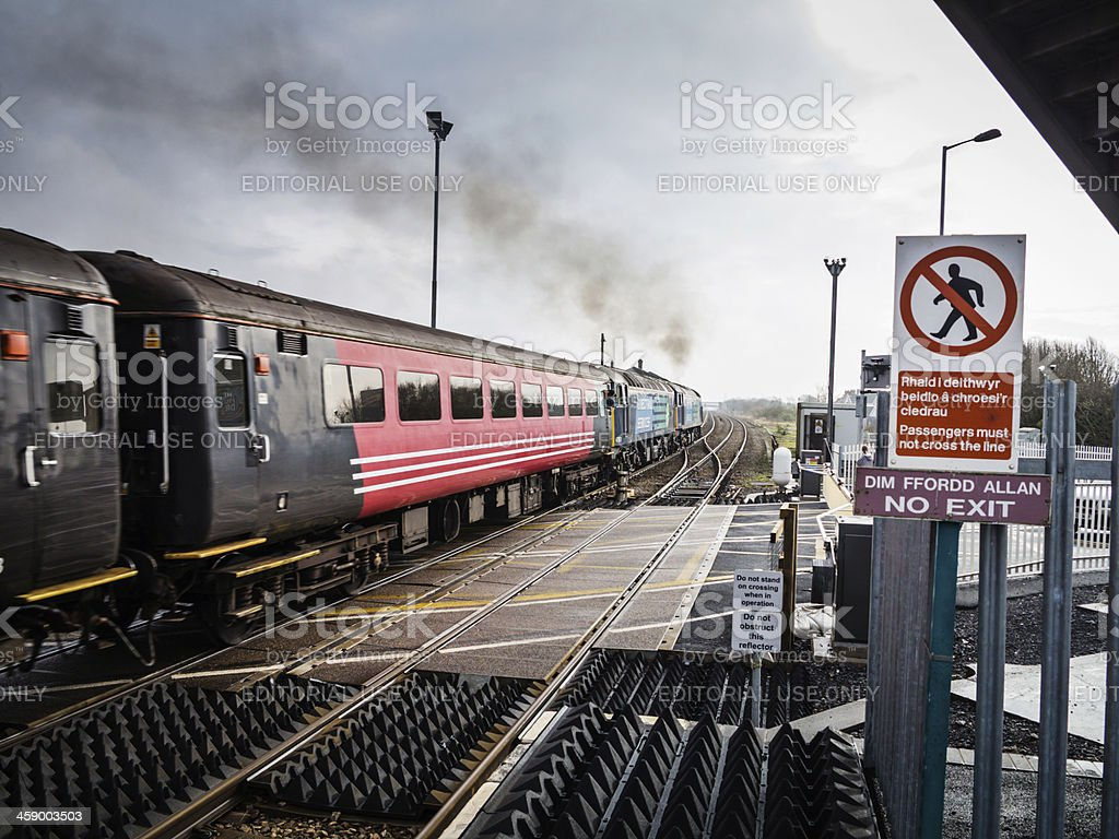 Old fashioned railway carriages pulled by two trains royalty-free stock photo