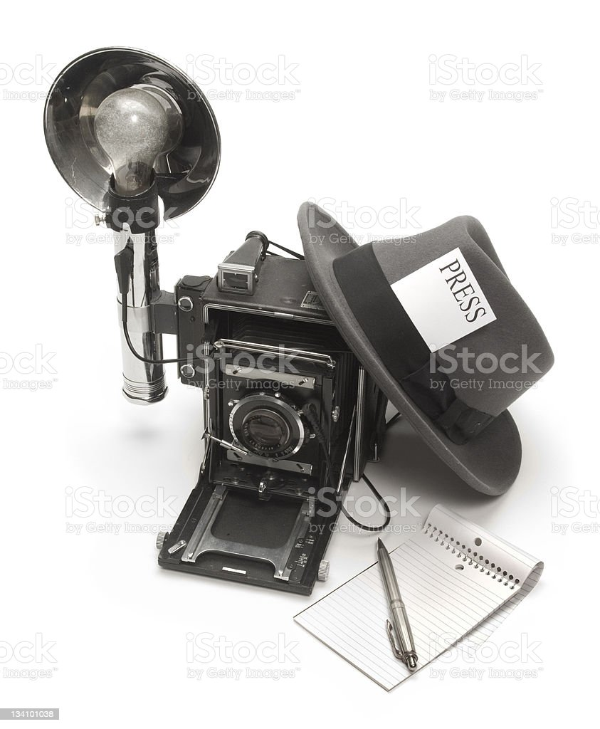 Old fashioned reporter equipment camera, notepad and hat royalty-free stock photo