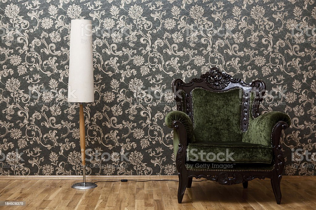 Old fashioned seat in living room with wallpaper royalty-free stock photo