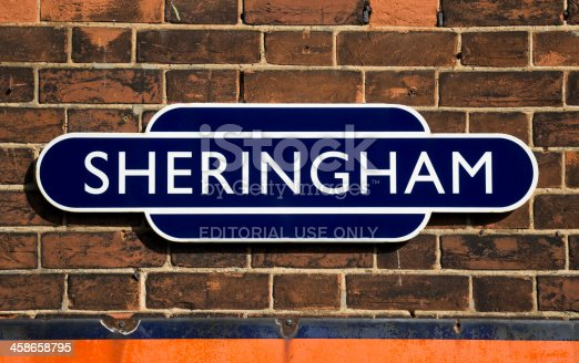 Sheringham, England - September 23, 2011: An old fashioned British Railways station sign at Sheringham, Norfolk. Sheringham is a typically English, traditional, seaside resort on the north coast of Norfolk; the railway station is very popular with families and tourists.