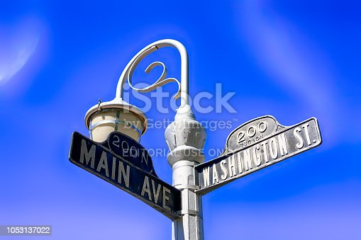 Old fashioned signpost on the corner of Main Ave and Washington St in downtown Tucson City, AZ