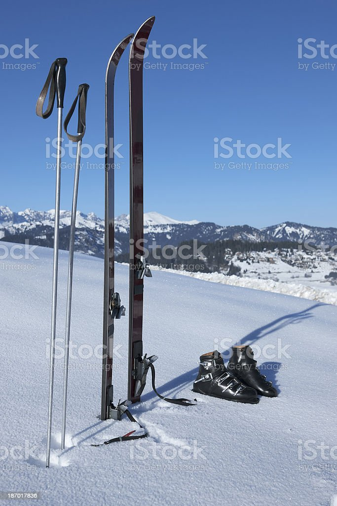 Old fashioned Ski's, boots and poles stood in the snow royalty-free stock photo
