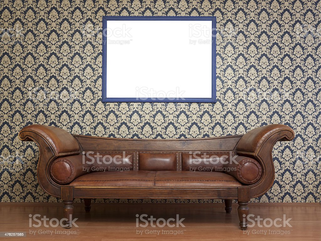 Old fashioned sofa in living room, empty frame on wall stock photo