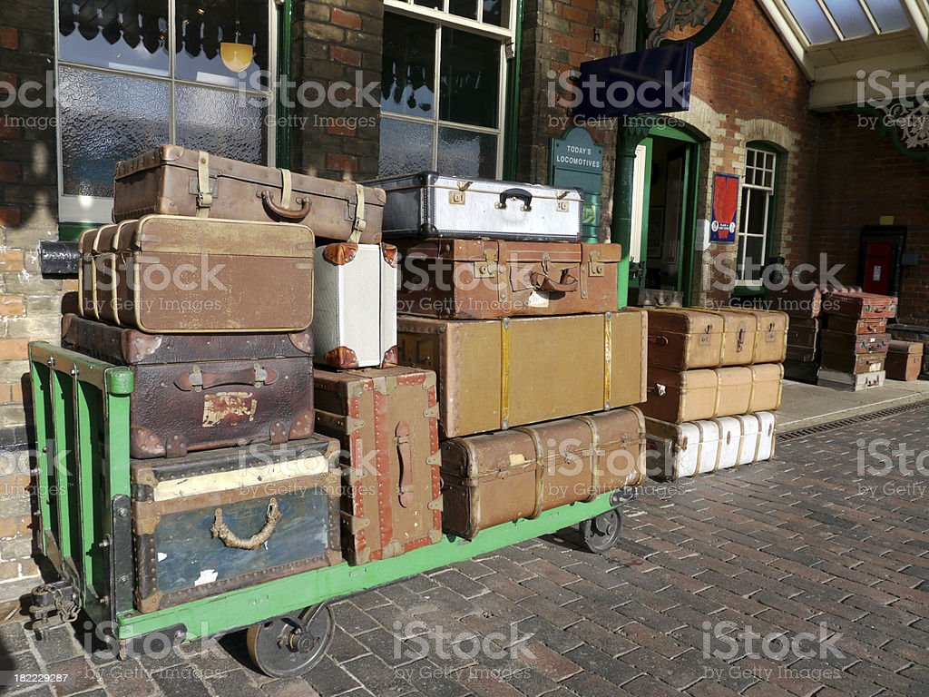 Old fashioned suitcases on the railway station platform royalty-free stock photo