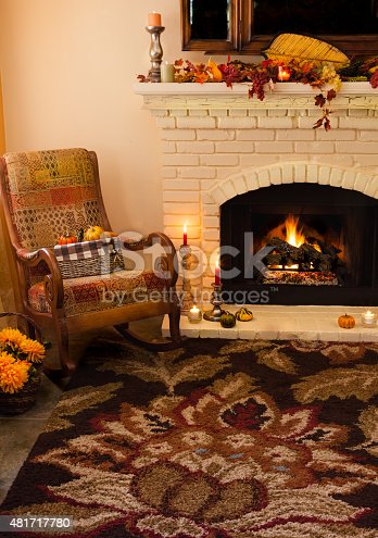 istock Old fashioned Thanksgiving fireplace and rocker in morning light -(P) 481717780