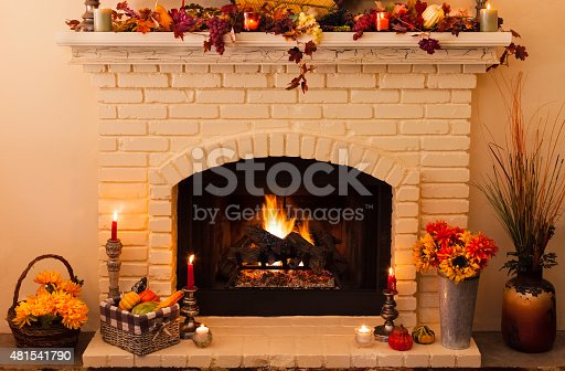 istock Old fashioned Thanksgiving fireplace with fire in morning light (P) 481541790