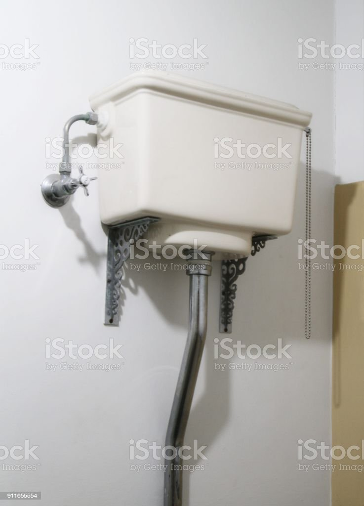 Old fashioned toilet cistern stock photo