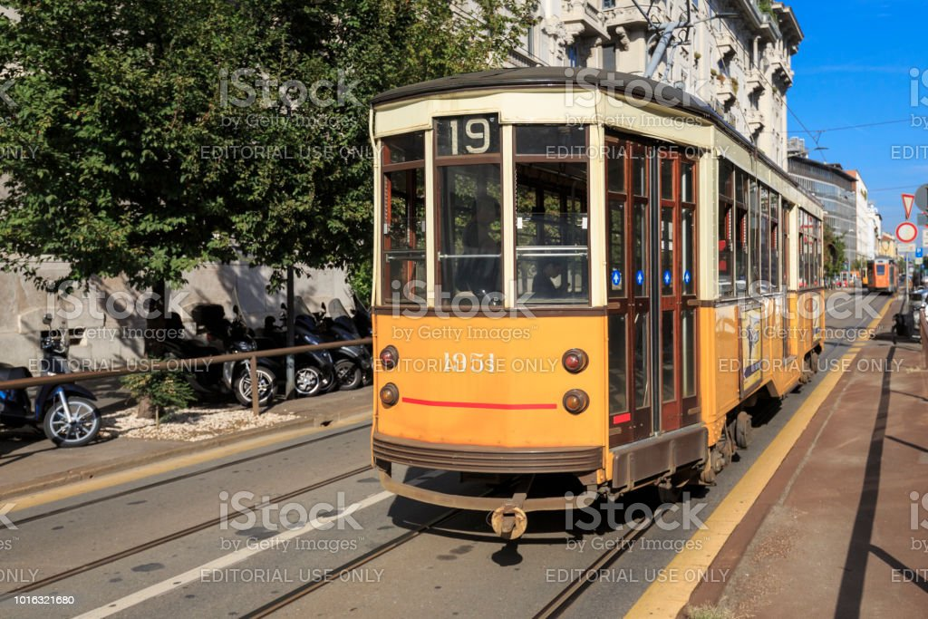 Old fashioned tram or streetcar, driving through Milan, Italy stock photo