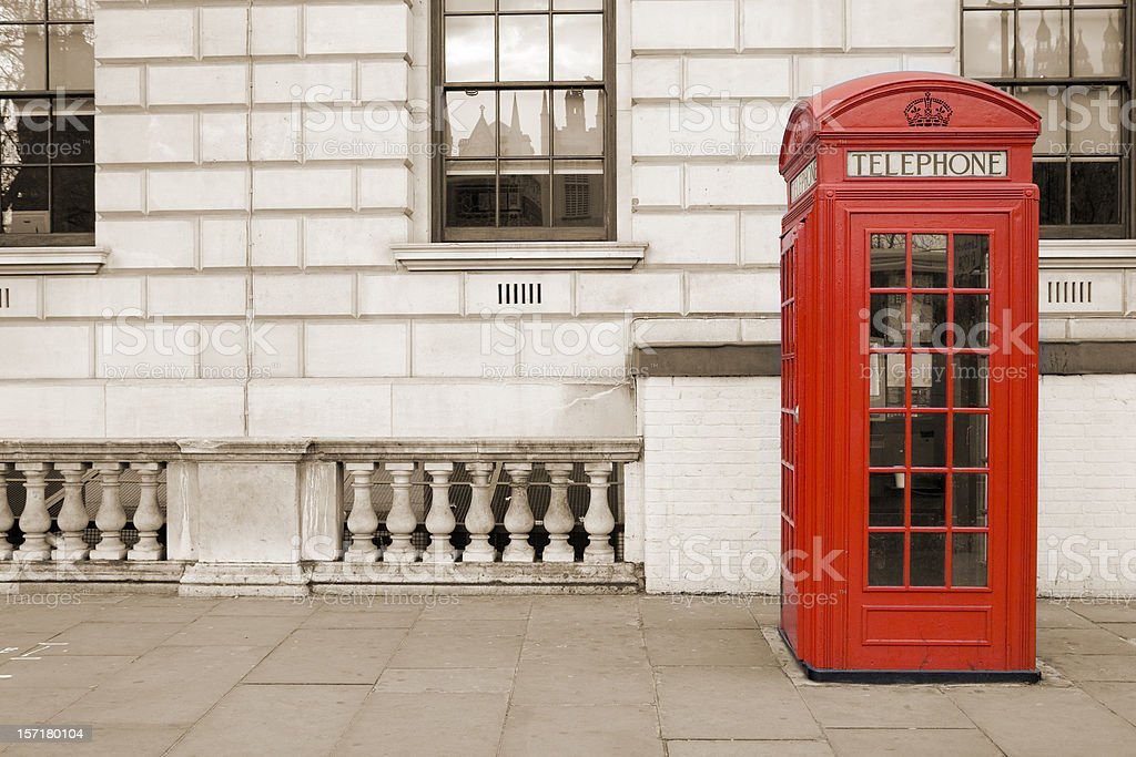 Old fashioned UK red telephone box on Whitehall, London stock photo