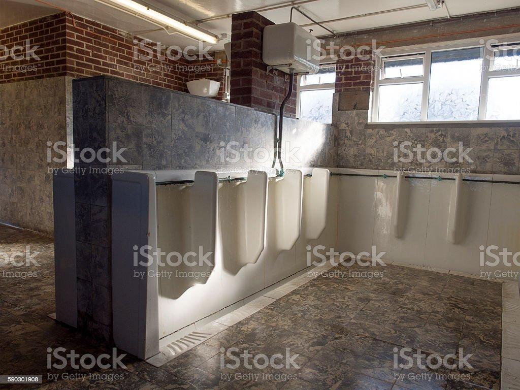 Old Fashioned Urinals in a Public Bathroom Стоковые фото Стоковая фотография