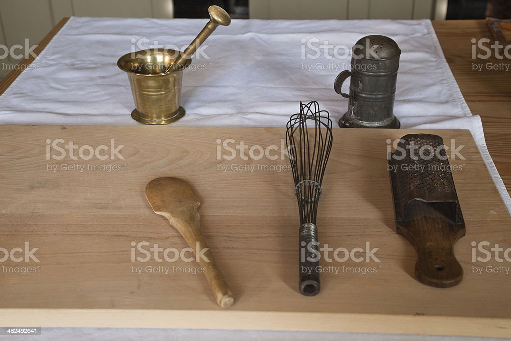 old fashioned Victorian kitchen implements on wooden table royalty-free stock photo