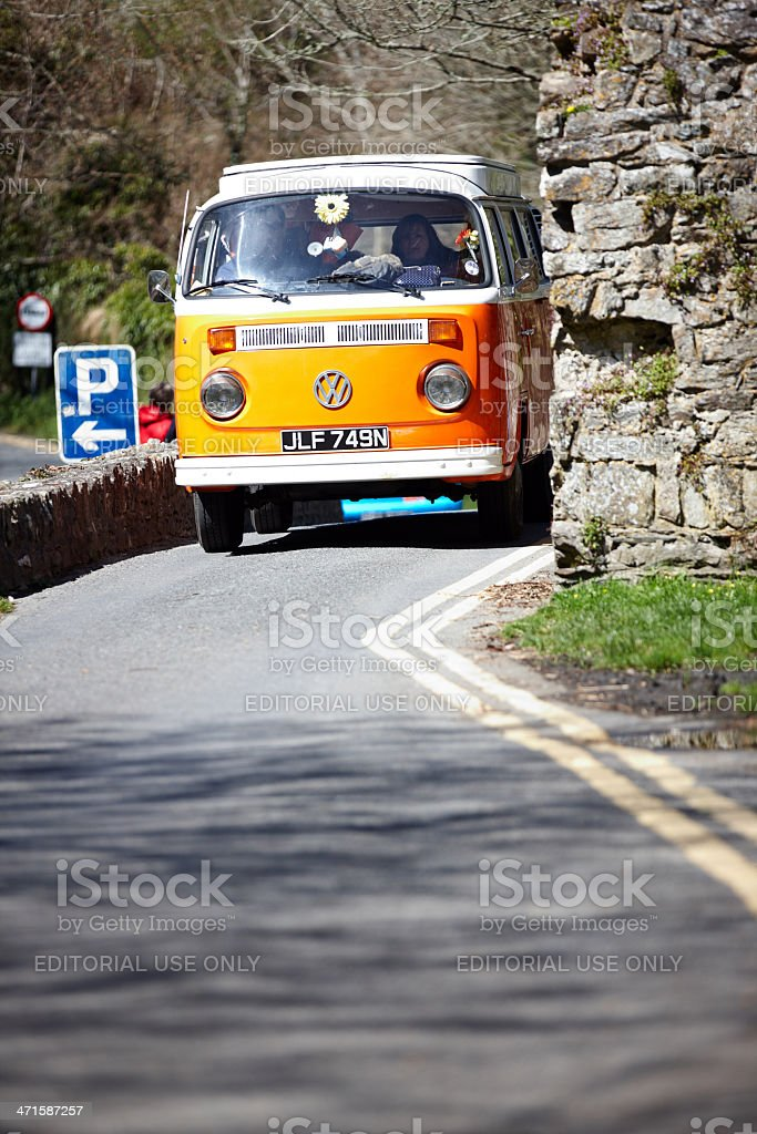 Old fashioned VW campervan on Welsh country lane stock photo