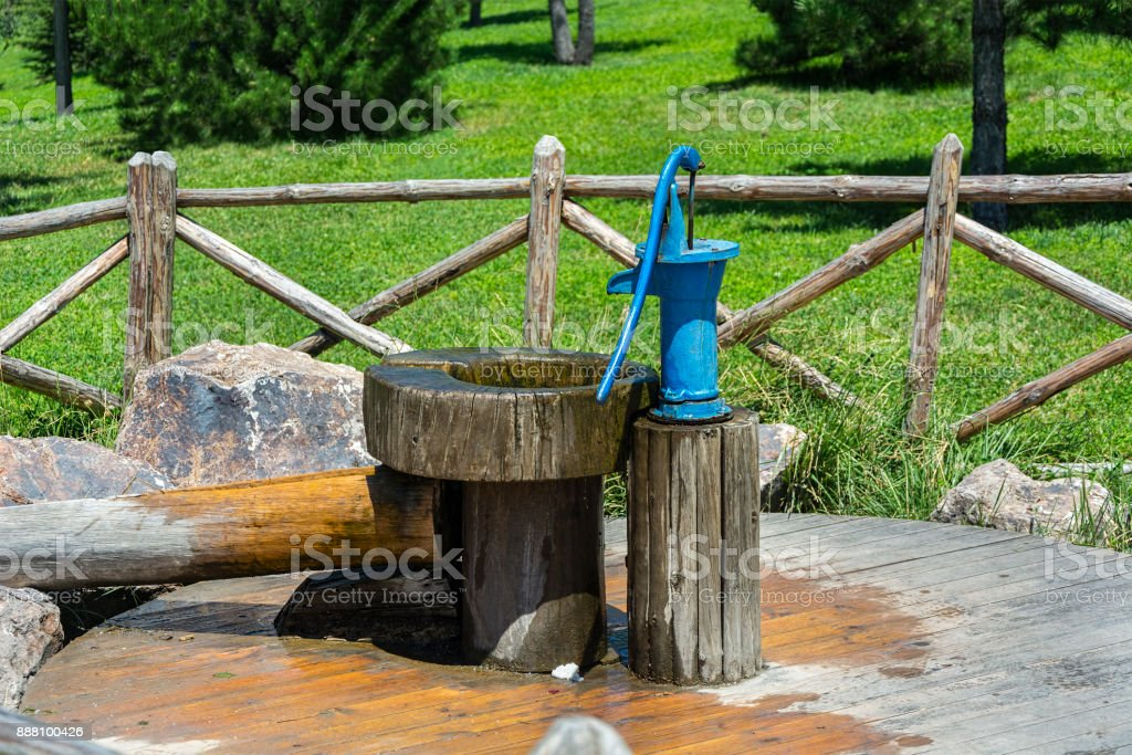 Old Fashioned Water Pump In Green Garden Stock Photo Download Image Now Istock