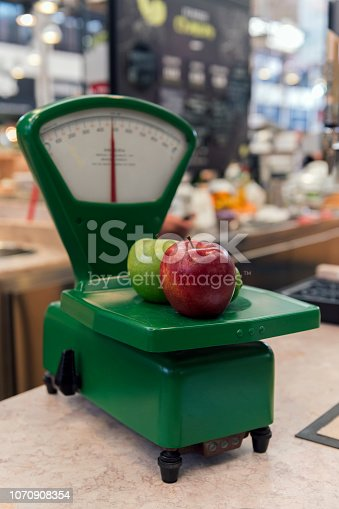 Old fashioned weight scale with fruits in Libon, Portugal
