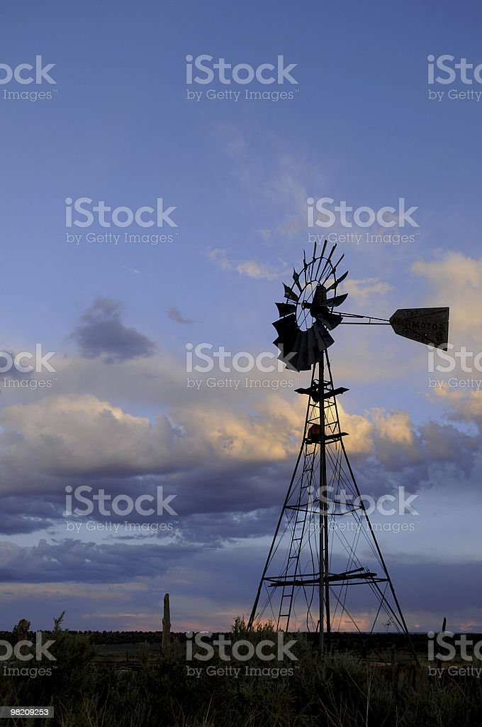 Old Fashioned Windmill Against Beautiful Sky at Dusk royalty-free stock photo