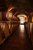 old fashioned wine cellar with wooden barique barrels