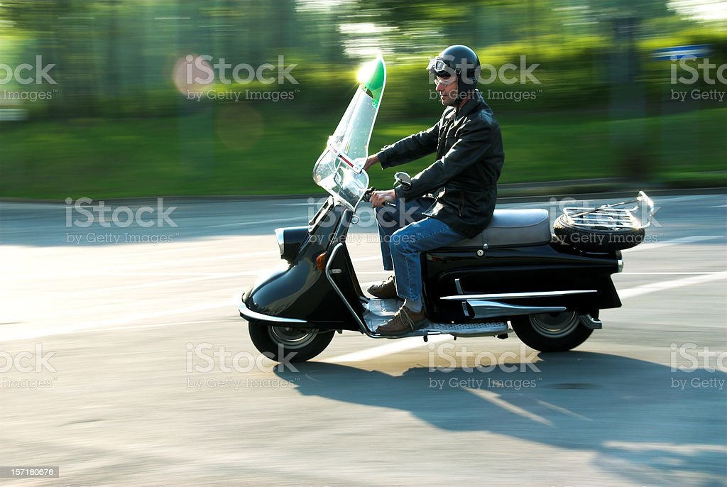 old fashionend motor-scooter stock photo