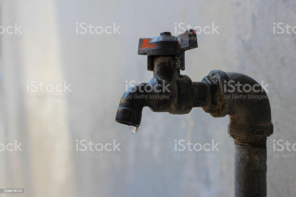 old faucet drop stock photo
