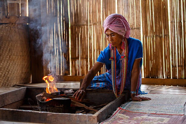 old female karen hill tribe is cooking traditional - burma home do стоковые фото и изображения