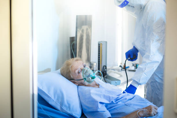 Old Female patients despaired in hospital beds stock photo