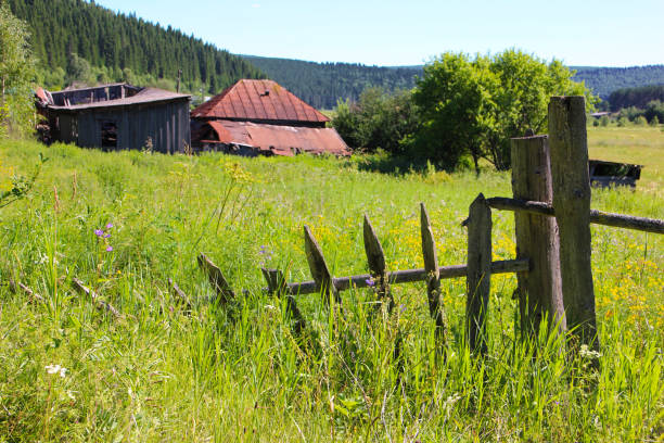 old fence and the house - palisade boundary stock photos and pictures
