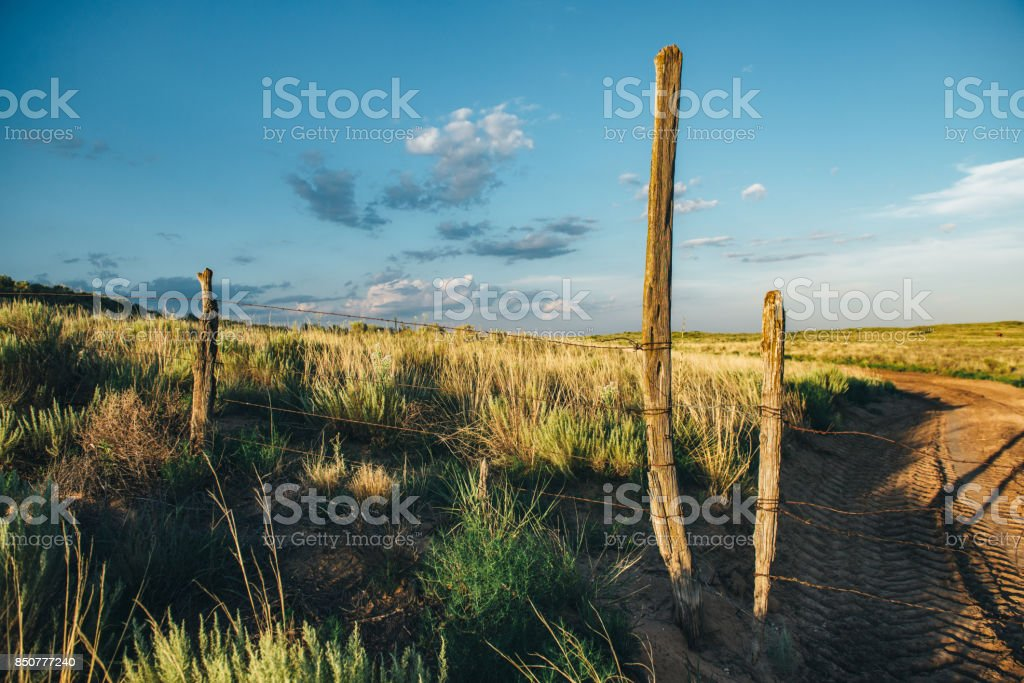 Old Fence on Overgrown Sandhills above the Ogallala Aquifer stock photo