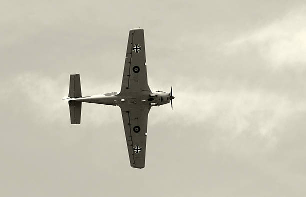 Old fighter airplane in black and white stock photo