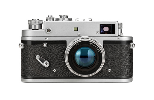 Old film camera isolated on white