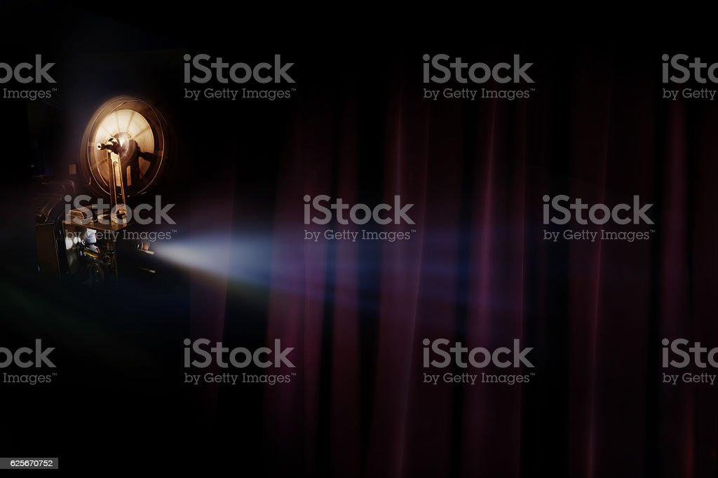 Old film projector with dark room background stock photo