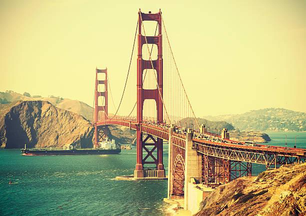 Old film retro style Golden Gate Bridge in San Francisco. stock photo